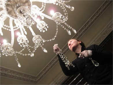 Mansion & Conservation Assistant, Sarah Marden, cleans Tatton's Dining Room chandelier web jpg