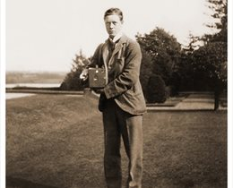 Black and white photo of Lord Egerton holding first camera