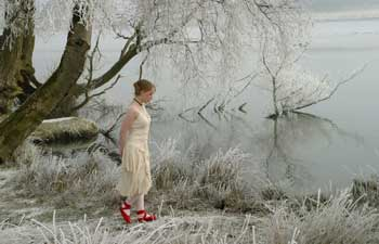 Girl in red shoes by Rob Vale
